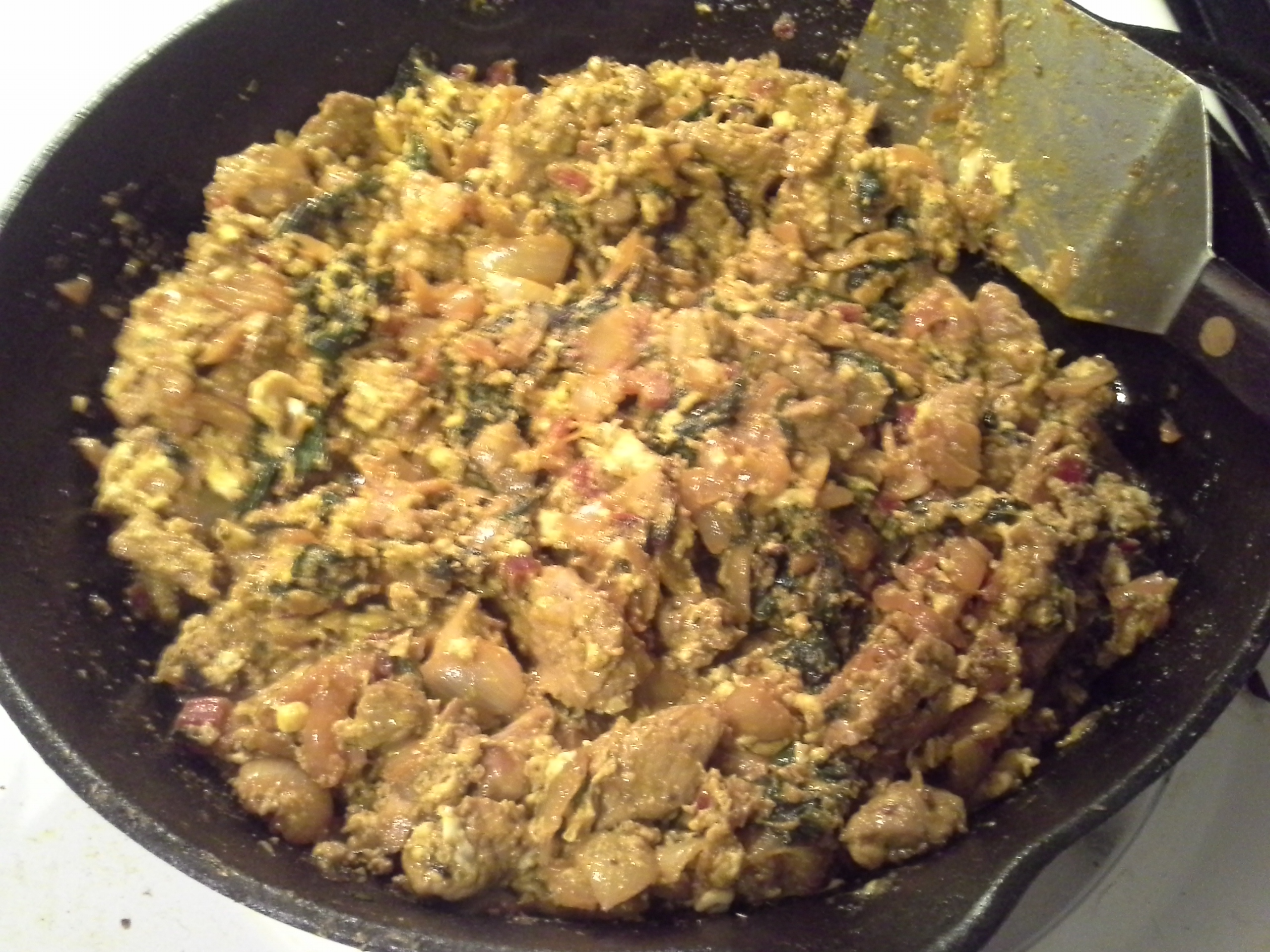 Dinner: 9:50 p.m. | 1/2 pork loin, 3 red chard leaves & stems, 1/2 sweet onion, 4 cloves garlic, 2 eggs, 2 Tbsp. red palm oil, herbs & spices