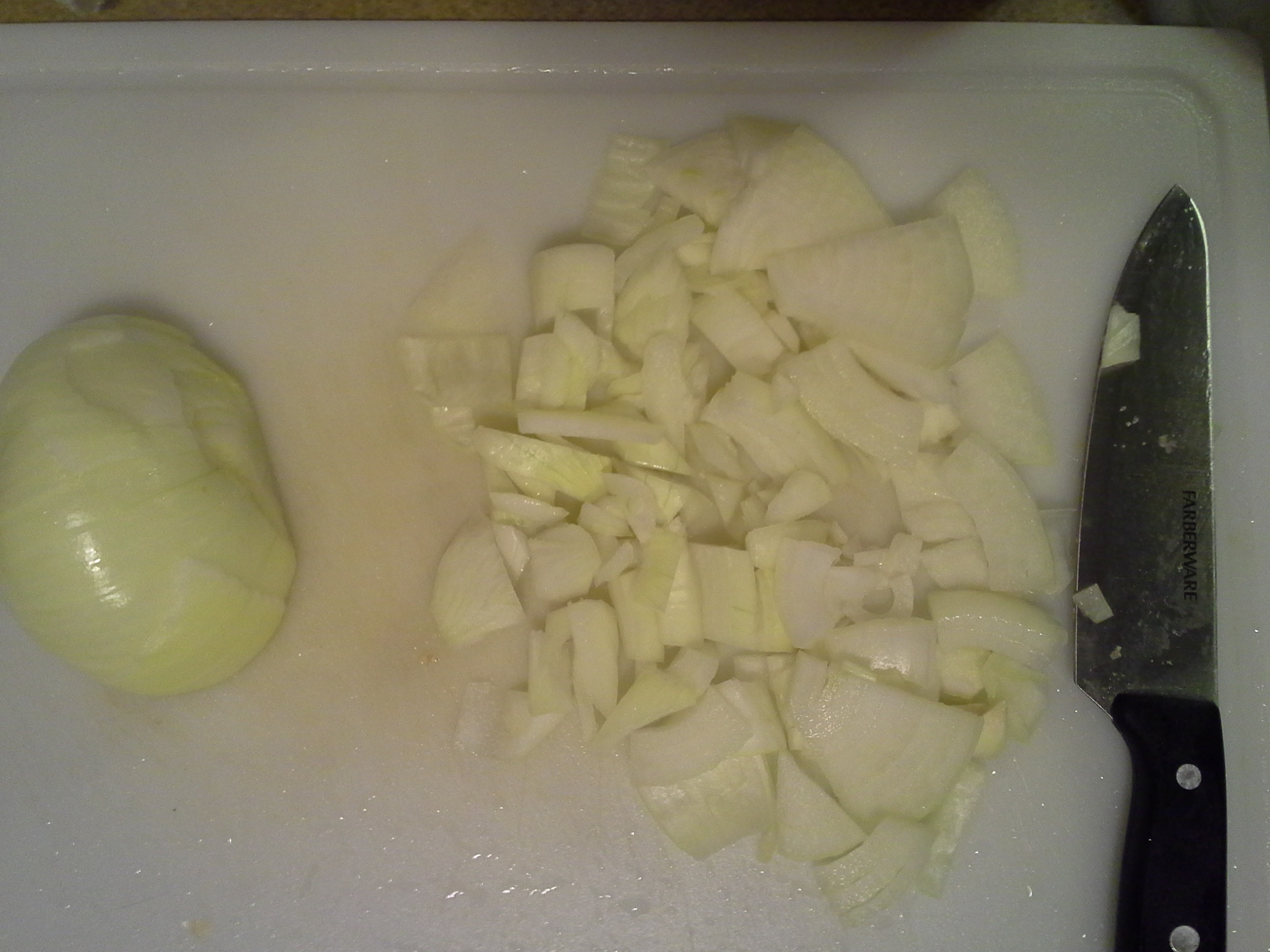 Dice an entire sweet onion and add it to the skillet