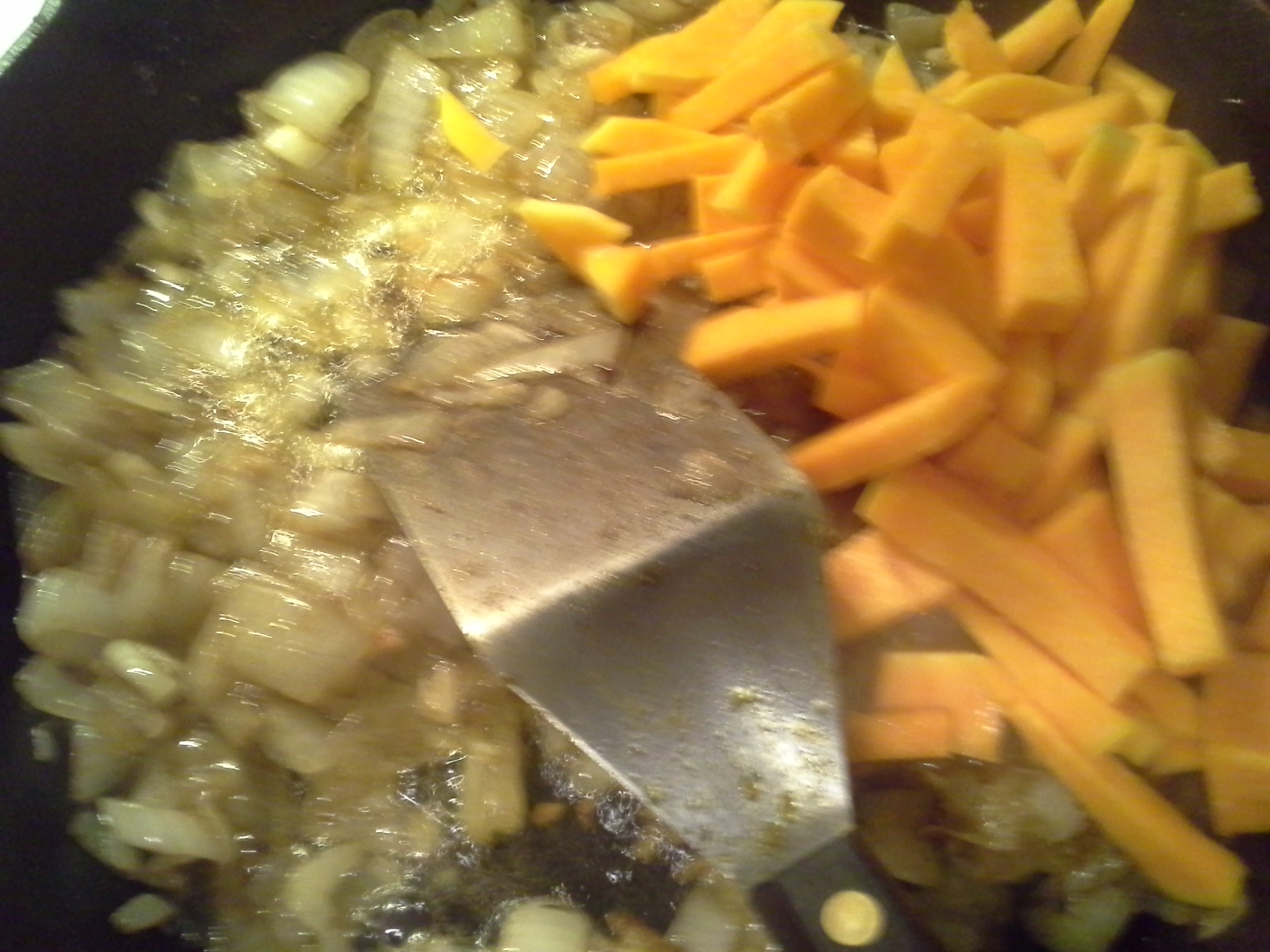 Add the squash to the onions and garlic, which are already beginning to brown