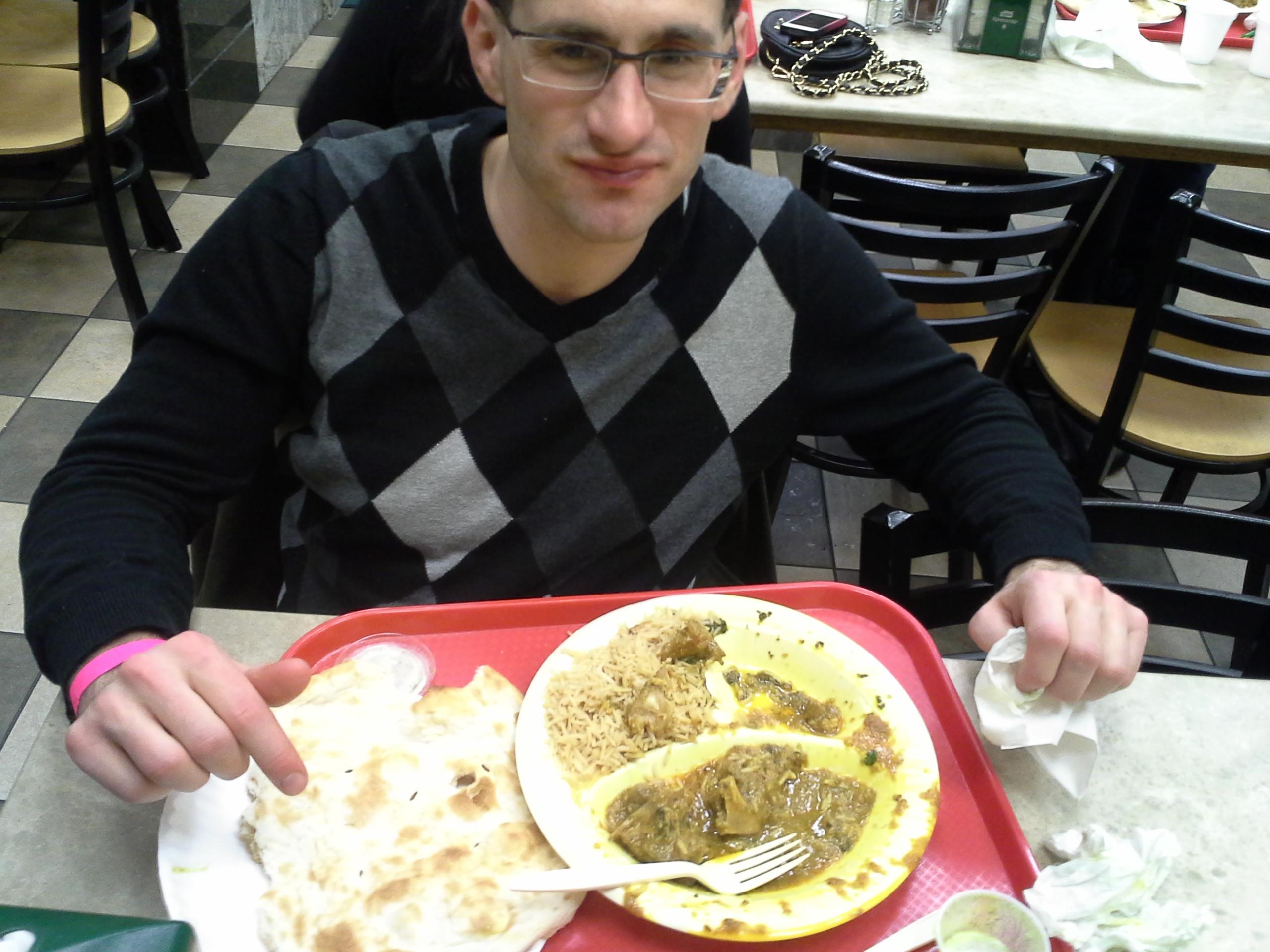 John Payne with a Kabob Palace lamb curry meal