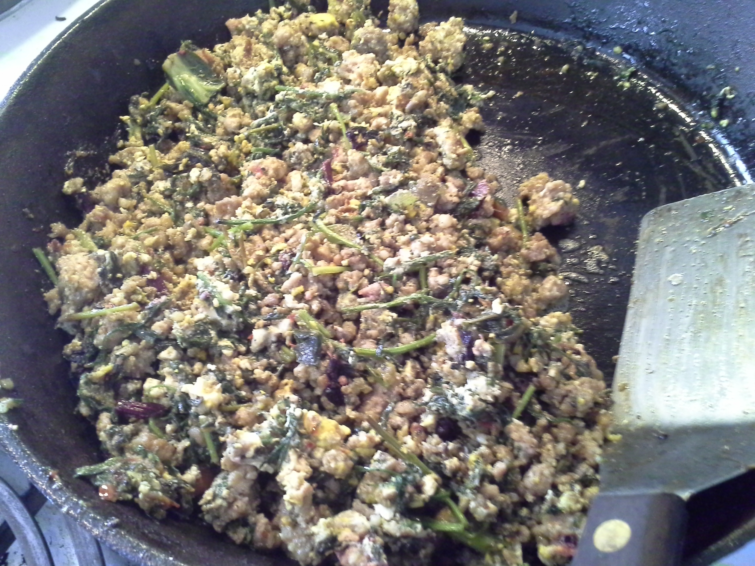 Breakfast: 10:50 a.m. | Pork sausage, eggs, carrot greens, greens mix, coconut oil, herbs & spices