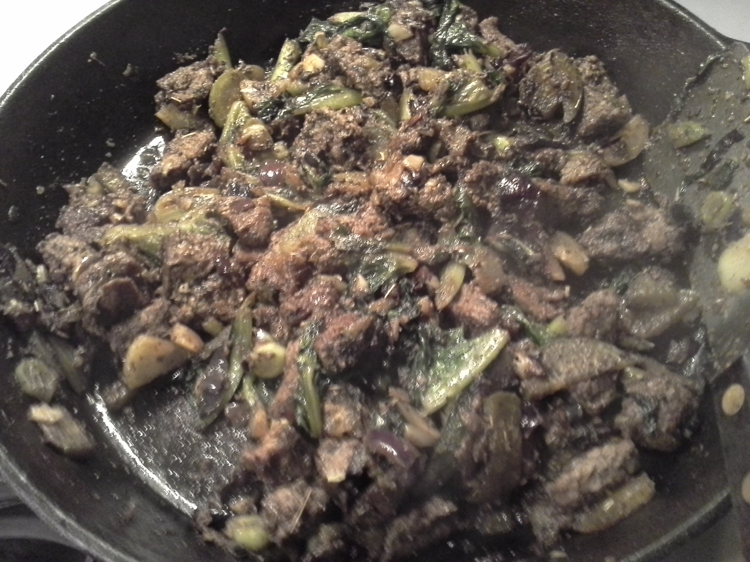 Dinner: 8:55 p.m. | Beef, 3 large leaves of mystery CSA greens, 1/2 daikon radish?, 1/2 red onion, 4 cloves garlic, 2 Tbsp. coconut oil, herbs & spices