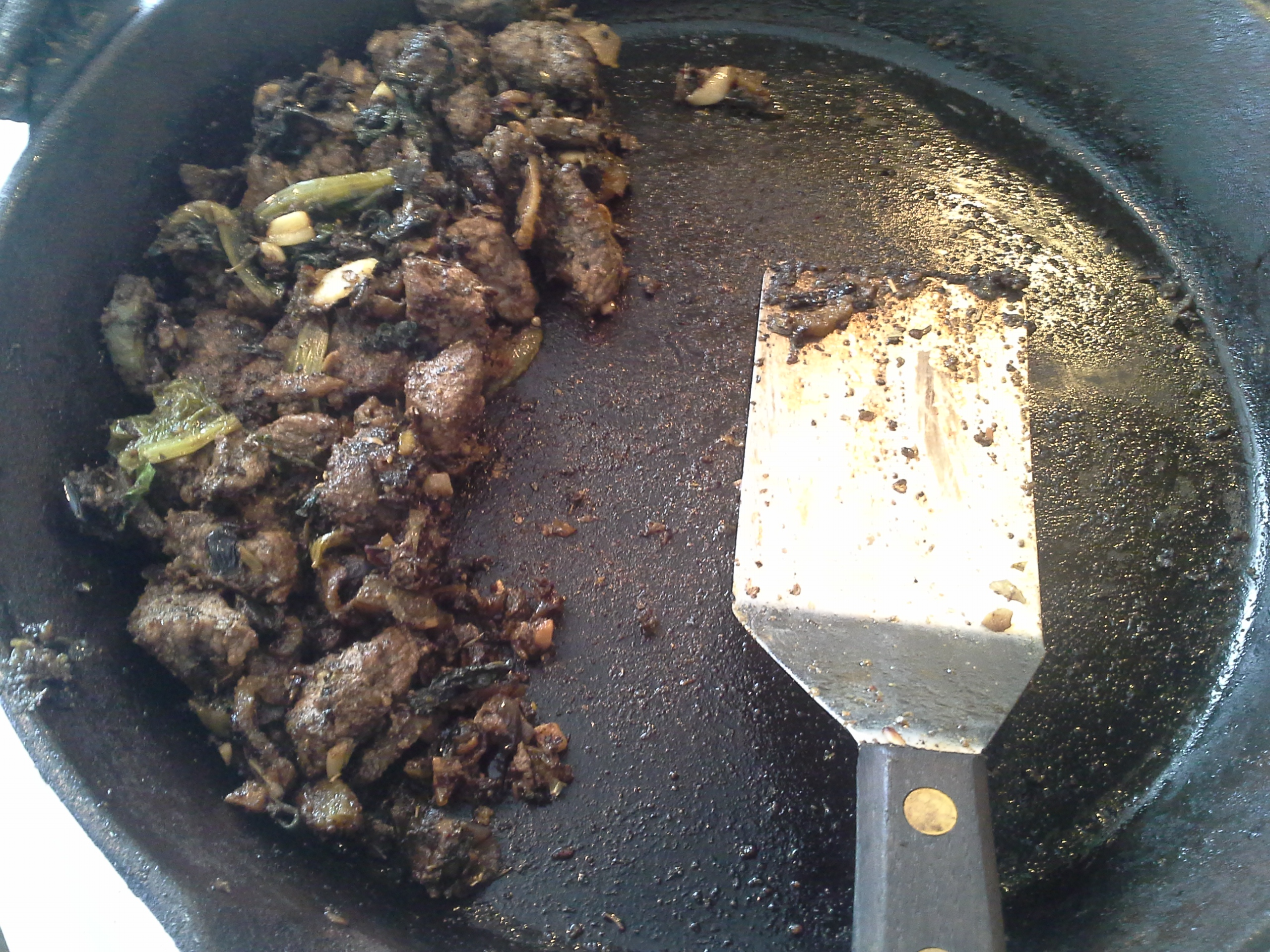 Beef, 3 large leaves of mystery CSA greens, 1/2 daikon radish?, 1/2 red onion, 4 cloves garlic, 2 Tbsp. coconut oil, herbs & spices