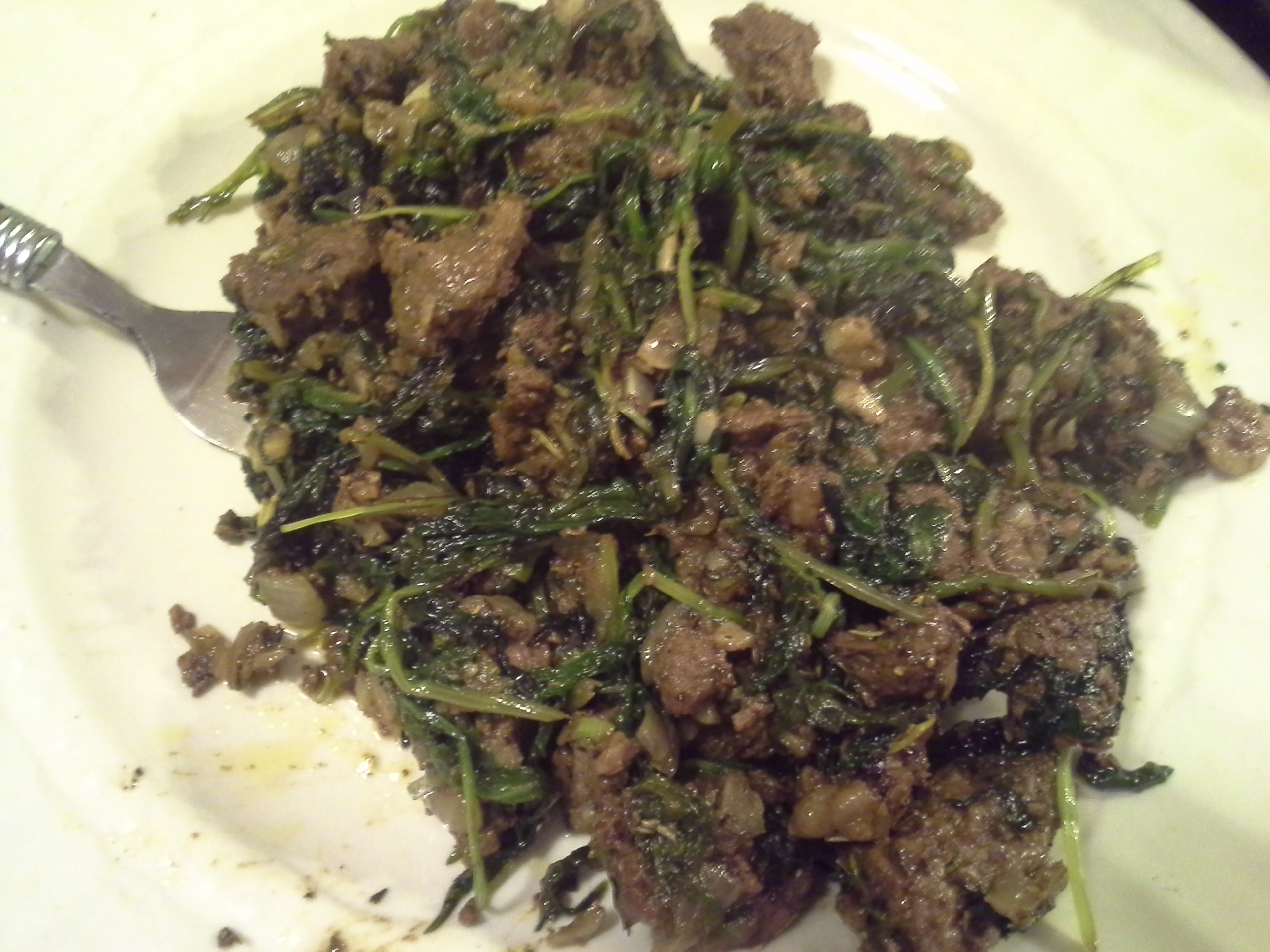 Dinner: 10:40 p.m. | 12.5 oz. steak, greens mix, 1/2 sweet onion, 4 cloves garlic, 2 Tbsp. coconut oil, herbs & spices